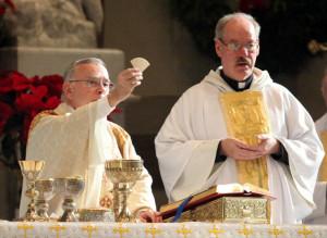 Archbishop Charles Chaput and Fr Richard Bennett, CSsR, pastor, celebrate Mass on the feast of Saint John Neumann.